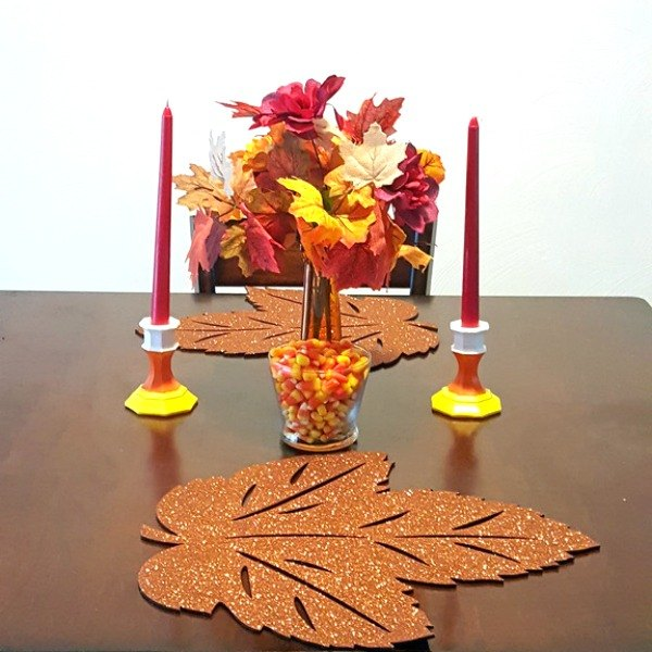 s 9 easy decor ideas inspired by delicious candy corn, seasonal holiday decor, wreaths, Scrumptious Candle Sticks