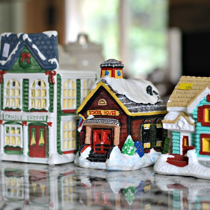 s 8 eerie halloween decorations made from unexpected things, halloween decorations, repurposing upcycling, seasonal holiday decor, Christmas Village from the Salvation Army