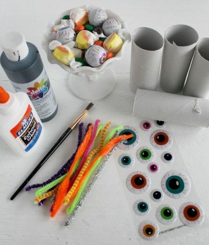 halloween kid craft candy filled toilet paper roll spiders, crafts, halloween decorations, seasonal holiday decor