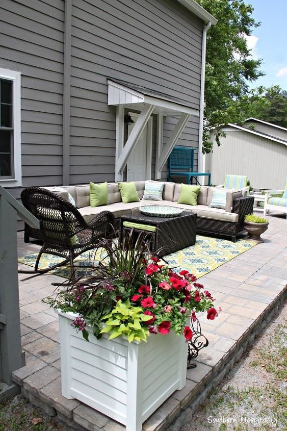 a paver patio installation, concrete masonry, landscape, outdoor furniture, outdoor living, patio