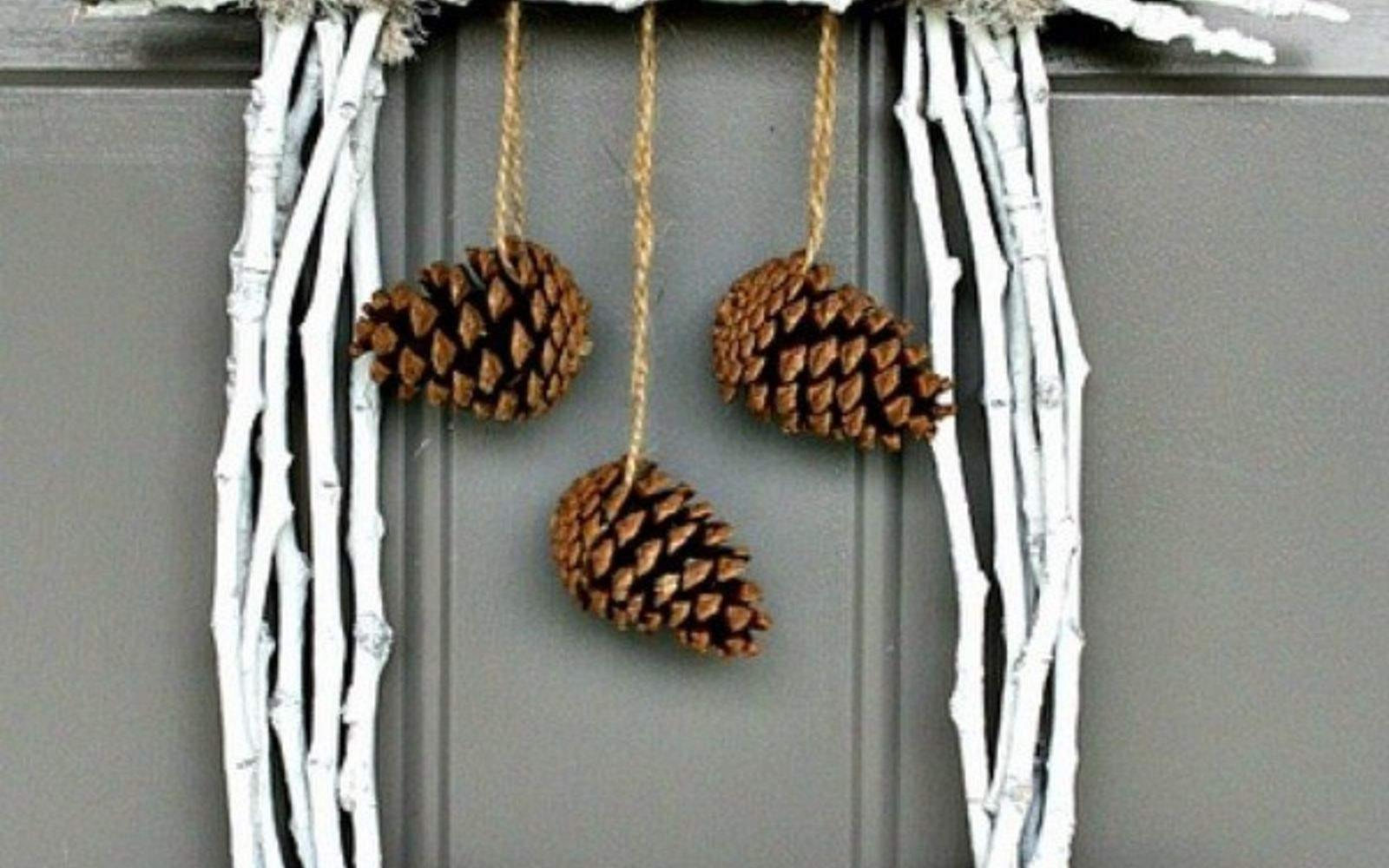s 13 reasons to rush outside and collect an armful of pine cones, christmas decorations, crafts, repurposing upcycling, seasonal holiday decor, Twig Door Hanger