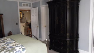 , We took the trim around the door all the way up to the crown molding and the same around the windows