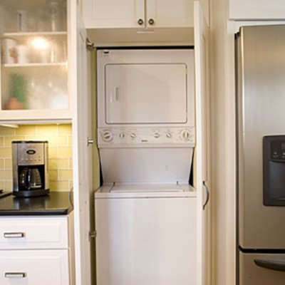 Anyone have ideas for hiding a washer and dryer in a small for Kitchen cabinet washing machine