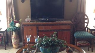 , I have the same set up My tv sits on a 58 console Drapes on Windows to frame it