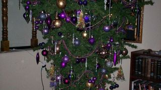 , It s a bit of work but when I got a Great Dane Puppy I had the same dilemma I used my old artificial tree placed pins to hold the sections together holes at the base and reinforced the hinged branches with wire and hung it upside down It is beautiful every year and really shows off the decorations