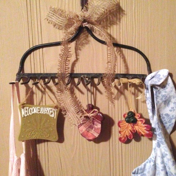s from your community 10 inexpensive shortcuts to a better holiday home, home decor, home improvement, repurposing upcycling, Add storage to your entryway with an old rake