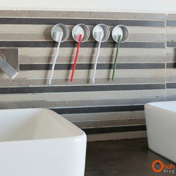 s 18 budget friendly home updates for guests, home decor, seasonal holiday decor, Add Easy Tooth Brush Storage
