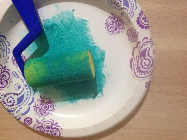 Put paint on a paper plate and load roller.