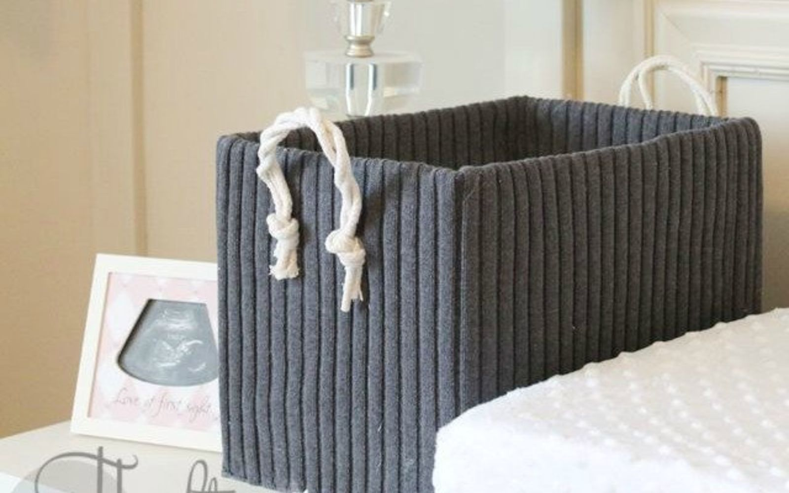 s 15 brilliant ways to reuse your empty cardboard boxes, home decor, repurposing upcycling, Cover It in an Old Sweater for a Cozy Look
