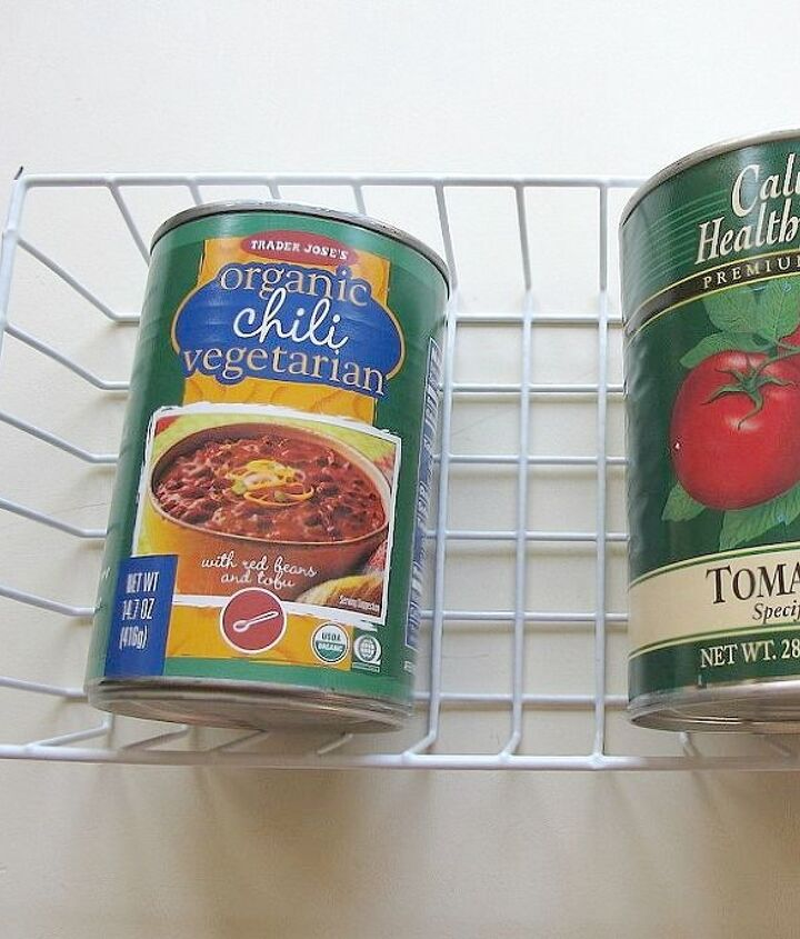 s here are 10 genius organizing ideas using dollar store bins baskets, organizing, storage ideas, Use baskets for canned food stacking