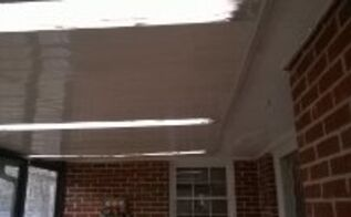 q back porch with a flat roof and sky lights leaks, home maintenance repairs, major home repair, porches, roofing