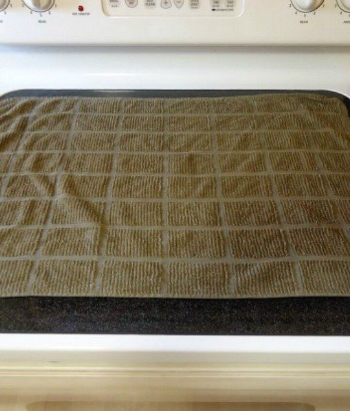 s 10 tiny changes to cut your cleaning routine in half, cleaning tips, Lay a towel on your glass stovetop