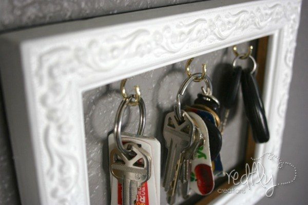s 23 insanely clever ways to eliminate clutter, organizing, storage ideas, Turn a Frame into a Key Rack