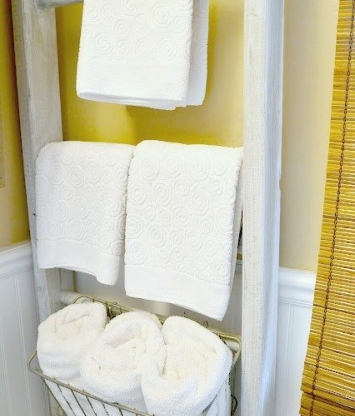 s 23 insanely clever ways to eliminate clutter, organizing, storage ideas, Organize Towels on a Ladder