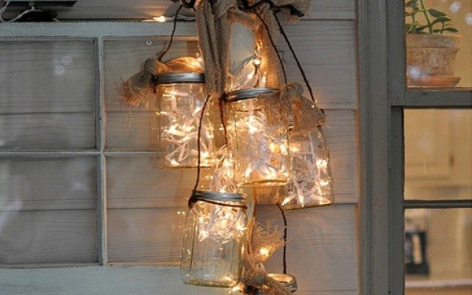 s 14 string light ideas that are cozier than your bed, bedroom ideas, lighting, Hanging Jar Lantern