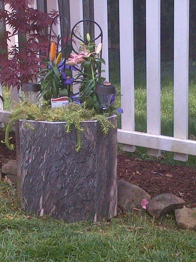 Old marble table base. Finally found something to do with it and it's lovely to look at while sitting in the back yard.