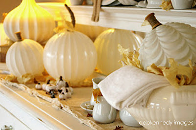 Glass Globe Pumpkin arrangement on a sideboard