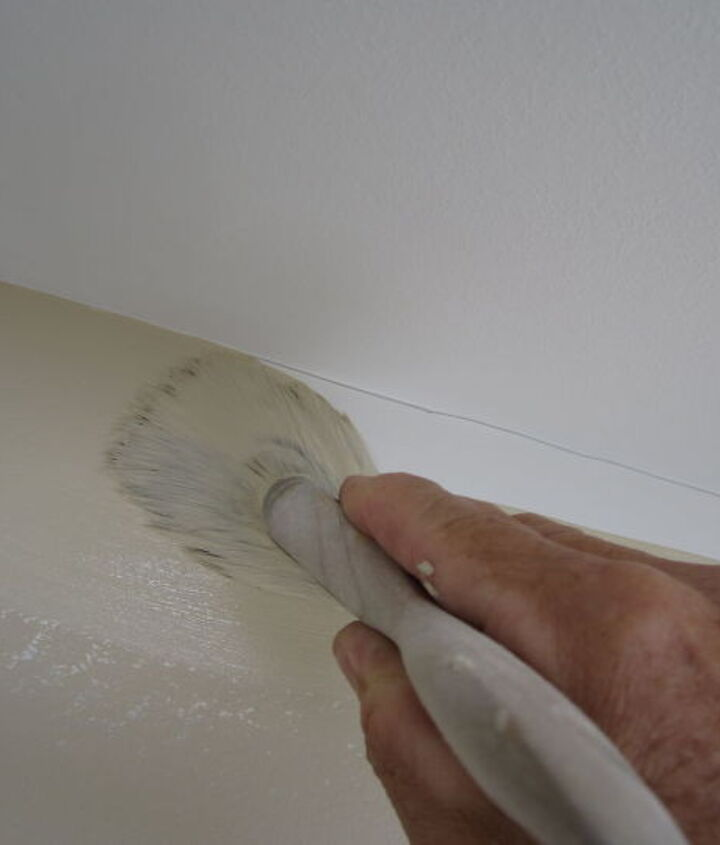painting a straight line at the ceiling trick, paint colors, painting, walls ceilings, Using a 3 inch brush loaded with paint just cover the line