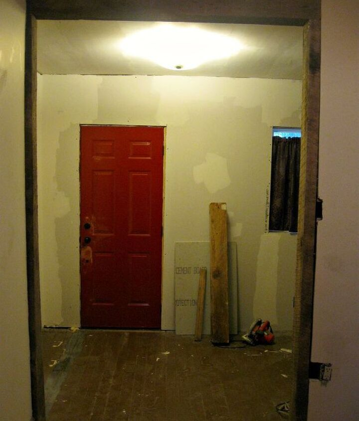 The inside of the front door will be repainted white but will remain red when open.  What color should the room be?