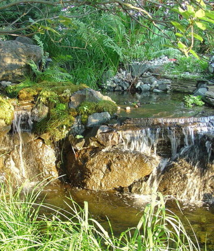 Natural looking backyard Waterfalls. Learn more about our waterfall construction, click on this link https://www.facebook.com/notes/bjl-aquascapes/waterfalls-waterfall-contruction-pondless-waterfalls-high-end-waterfall-design-b/1483816