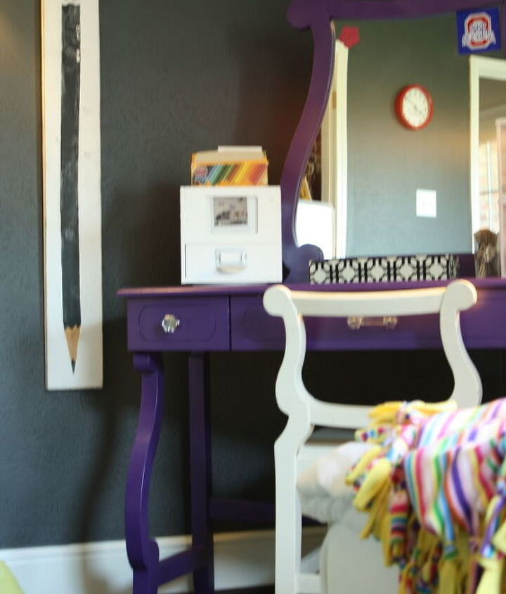 We used a purple spray paint to give her vanity a new look.