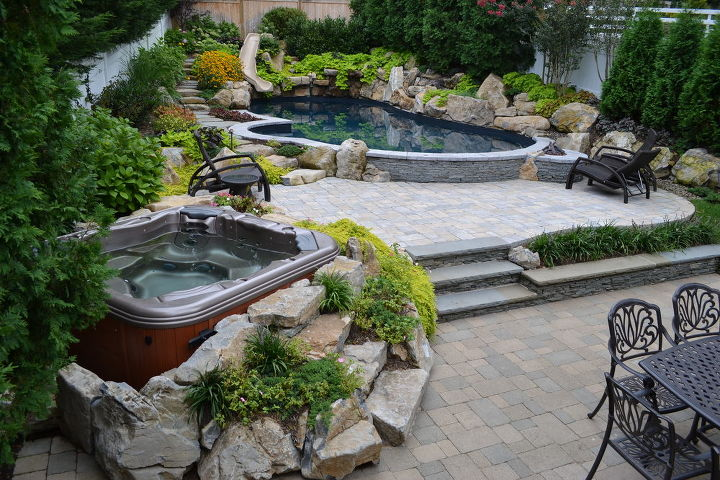 Pool and Spa in small backyard with large boulders Aquascape waterfall, and landscaping