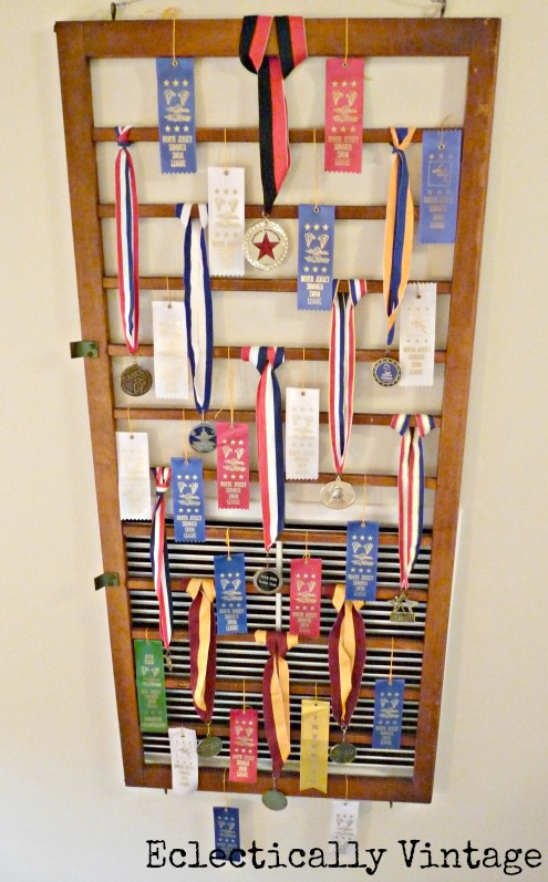 Cover an ugly wall vent - get creative by using an old crib railing to display award ribbons.  http://eclecticallyvintage.com/2012/08/and-the-ribbon-goes-to-creatively-disguising-an-ugly-wall-vent/