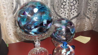 q my recent jewelry tiers, crafts, These are my new glass balls I got on the Oregon Coast So many glass blowing places and so many artists Gorgeous stuff When The sun comes in the morning these really sparkle