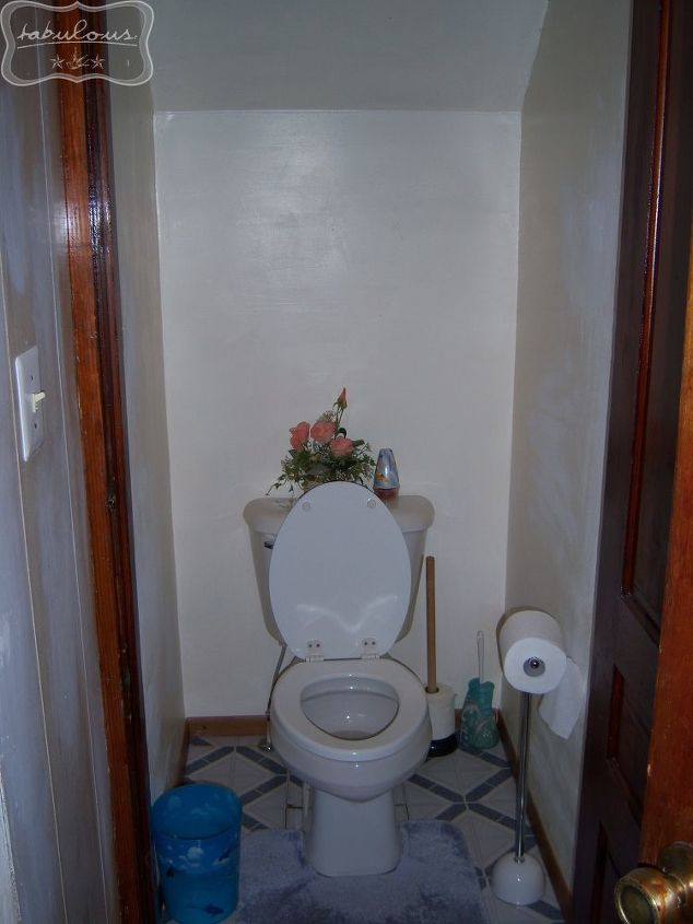 How the toilet area was when we bought the house -- there was a stick bolt on the outside of the door that when closed, hit your knees if you were sitting on the toilet.