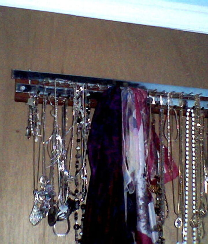 It is hidden behind my bedroom door. I use it to organize my necklaces, bracelets  and scarves. It has both hooks w/caps and loops, which swing open for easy removal and closes to keep items secure.