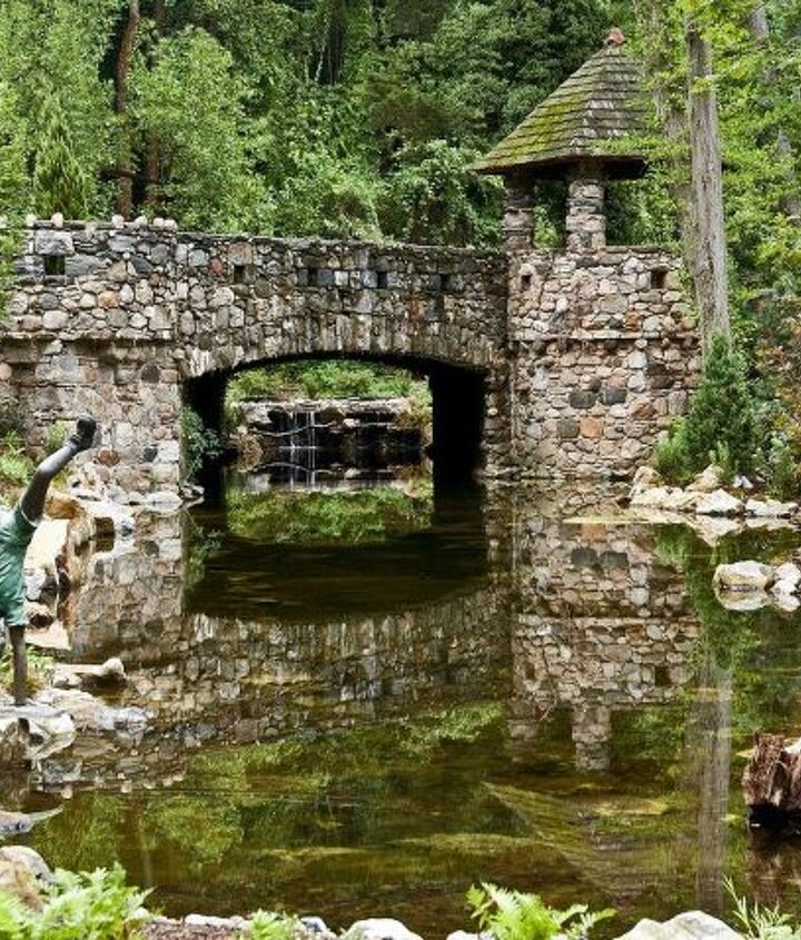 Large pond with stone bridge and turret with awesome reflection built on Long Island by Deck and Patio Company www.deckandpatio.com
