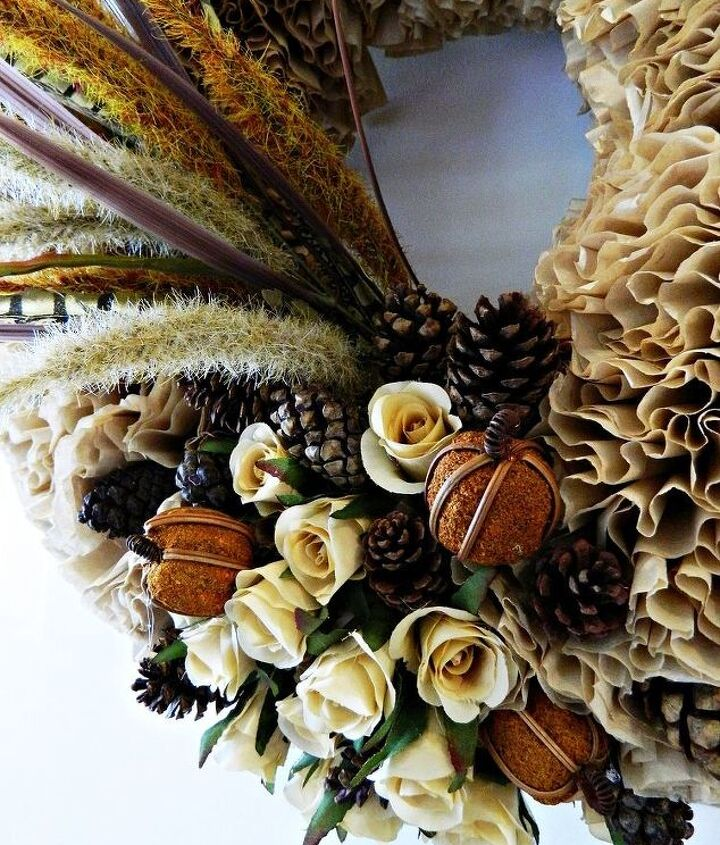 A couple of hours will get you a pretty spiffy and inexpensive new fall wreath.  Unbleached coffee filters, a foam wreath and the decorations of your choice.  Pretty great results from a whole lotta nothin.  http://www.recapturedcharm.com/2012/09/fall-coffee-filter-wreath.html