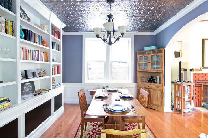 """The bookcase was actually installed in front of a radiator shared with the adjacent room, so we had to seal the inside wood and use foam insulation to protect the casework. The black screen is """"radiator screen""""."""