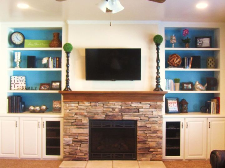 Stone Hearth Fireplace And Open Background Shelving Unit