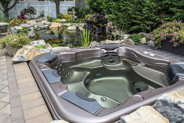Bullfrog spa with jet paks overlooks the pond and waterfall. http://www.deckandpatio.com/DP_Blog/