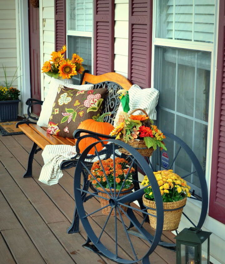 enjoyed decorating with my new yard sale find - a huge iron wagon wheel planter