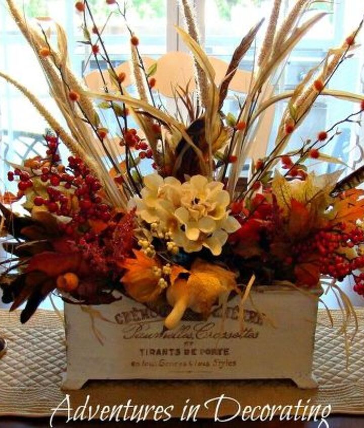 The planter that I painted and added a French image to has become our Fall centerpiece.