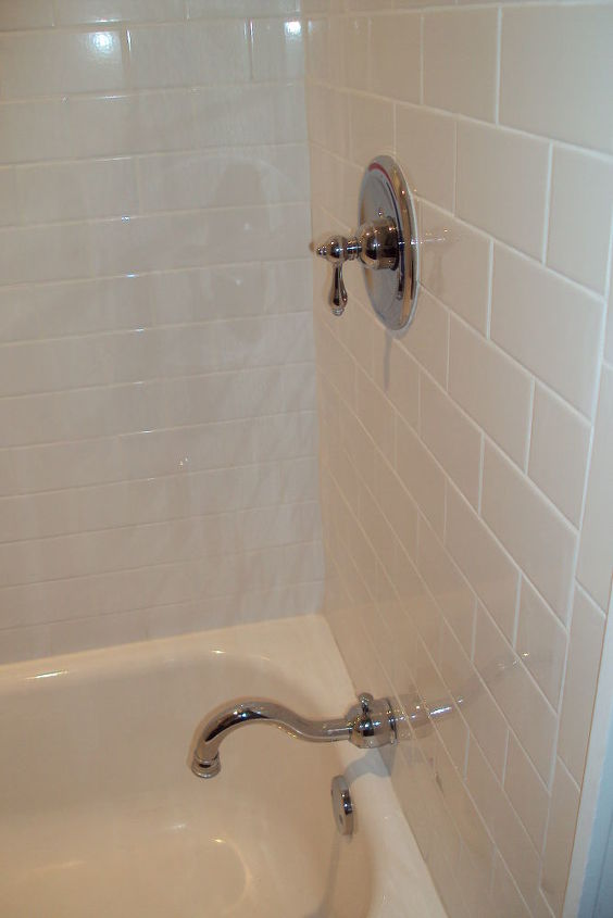 New tub with subway tile (we also tiled the ceiling & added a recessed light in the shower area).