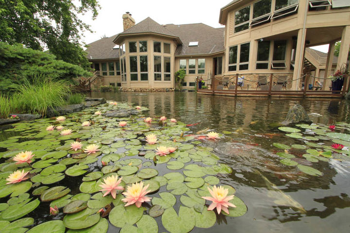 The one-acre pond flows right up to the home. Expansive windows provide waterfront views from numerous rooms in the home.