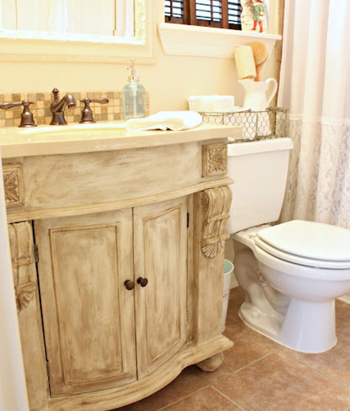 Custom painted french vanity. http://www.frommyfrontporchtoyours.com/2011/12/guest-bathroom-reveal.html