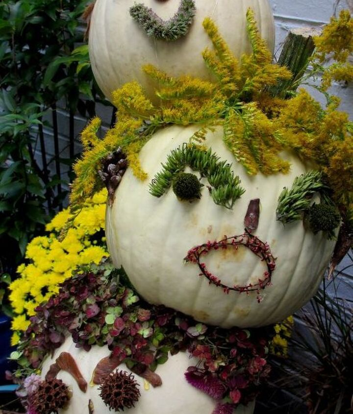 Decorated the kitchen deck today and made tipsy punkin' heads using white pumpkins and natural materials our garden. Don't they have personality?http://pinterest.com/barbrosen/