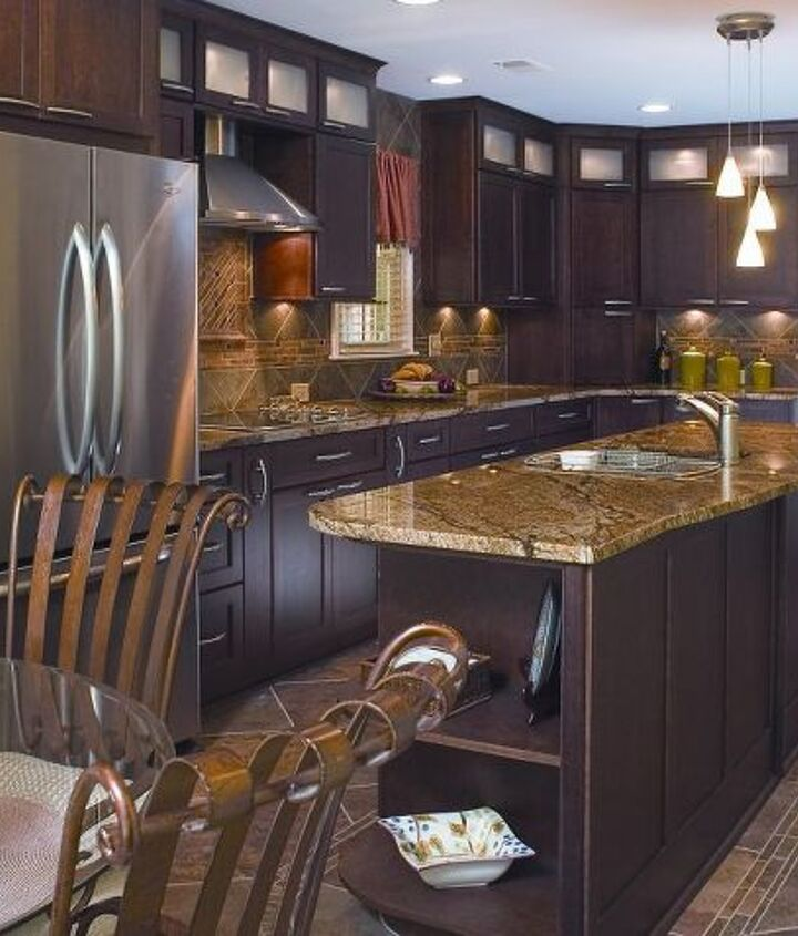 The new kitchen boasts an incredible amount of customized storage, rich textures, colors a professional design plan that suited their unique lifestyle and acclaimed tile design. Read more about the changes: http://bit.ly/ODeX8U