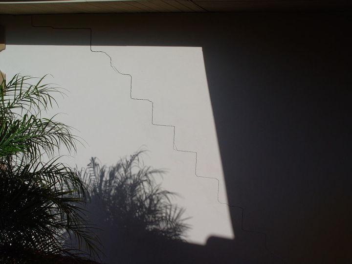 outside garage crack in wall
