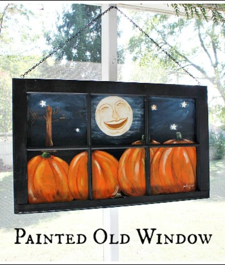 old window painted with a fall scene, repurposing upcycling, seasonal holiday decor