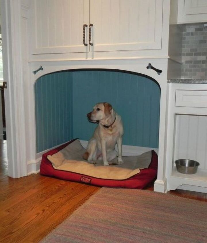 There are two dog beds in the mudroom. One one either side of the sink. Photo is a closeup photo of one of the dog bed. Mudroom cabinetry handcrafted in Titus Built, LLC's millwork shop located in West Redding, CT.