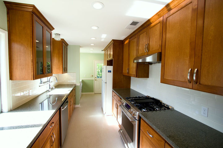 After- New flooring, appliances, granite counter tops, tile backsplash, paint, and electrical and plumbing fixtures were provided to make this kitchen more functional and up to date.