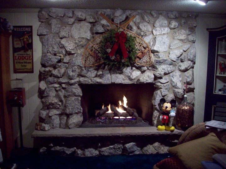 Here is it - sorry the Christmas picture is the only one I currently have.  :-)  It is in great shape and the hearth is also in perfect working condition.  But is it too dated?