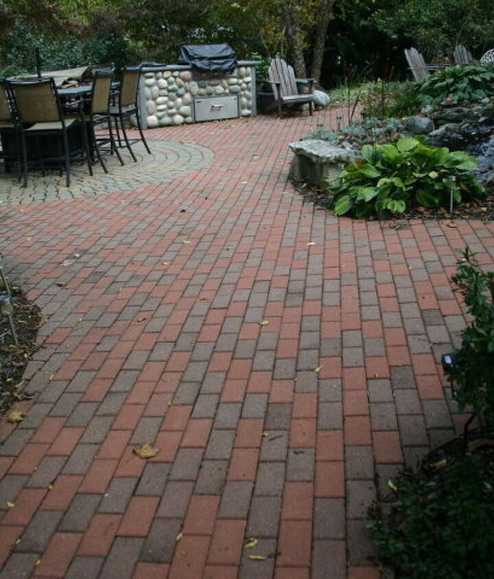 We took up the old patio created our own pattern and blend the old with the new