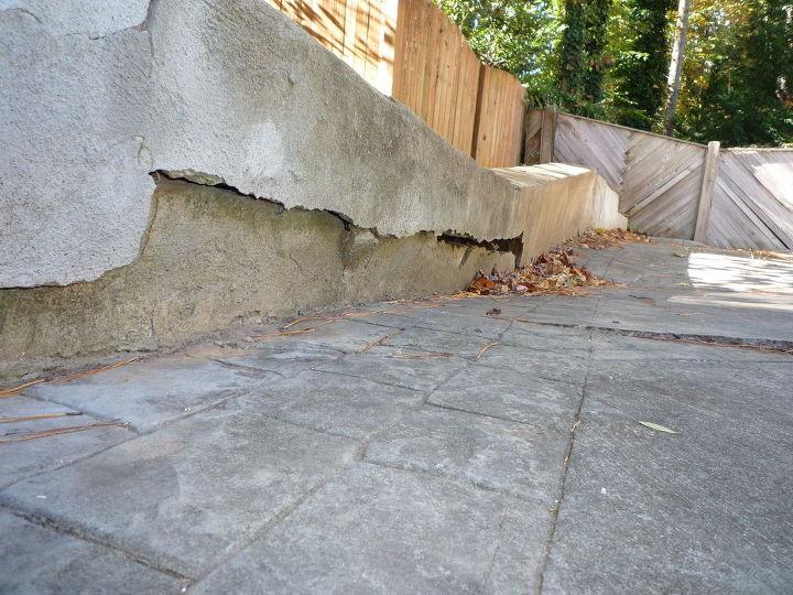 q sink hole under driveway retaining wall, concrete masonry, home maintenance repairs, outdoor living