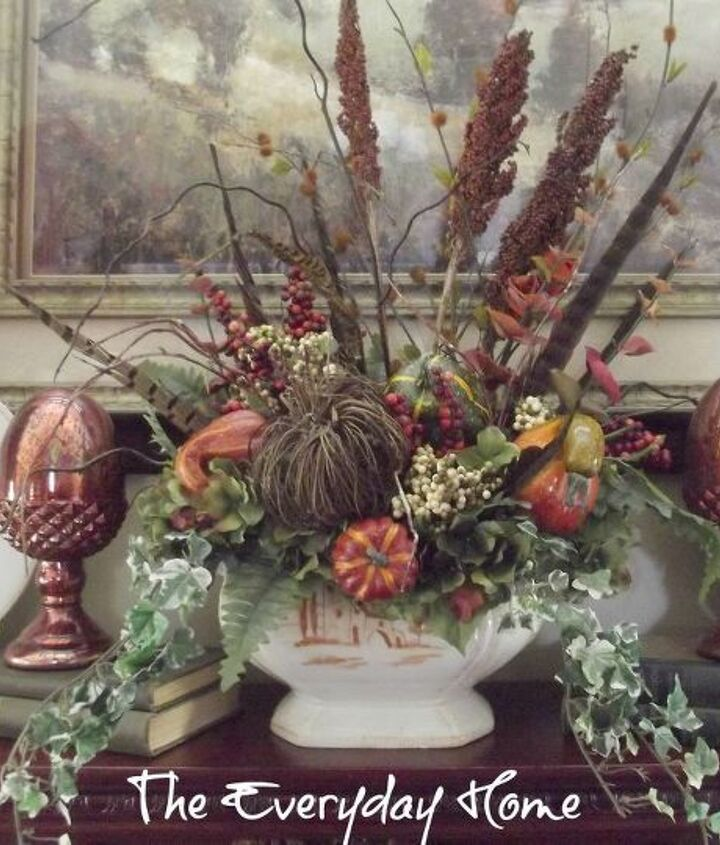 "I continued the same ""woodsy"" theme as throughout the rest of my home, using lots of natural elements.  This arrangement is inside a Vietri Soup Tureen called ""Bramasole."""